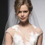 Capelli sposa Chignon alto morbido