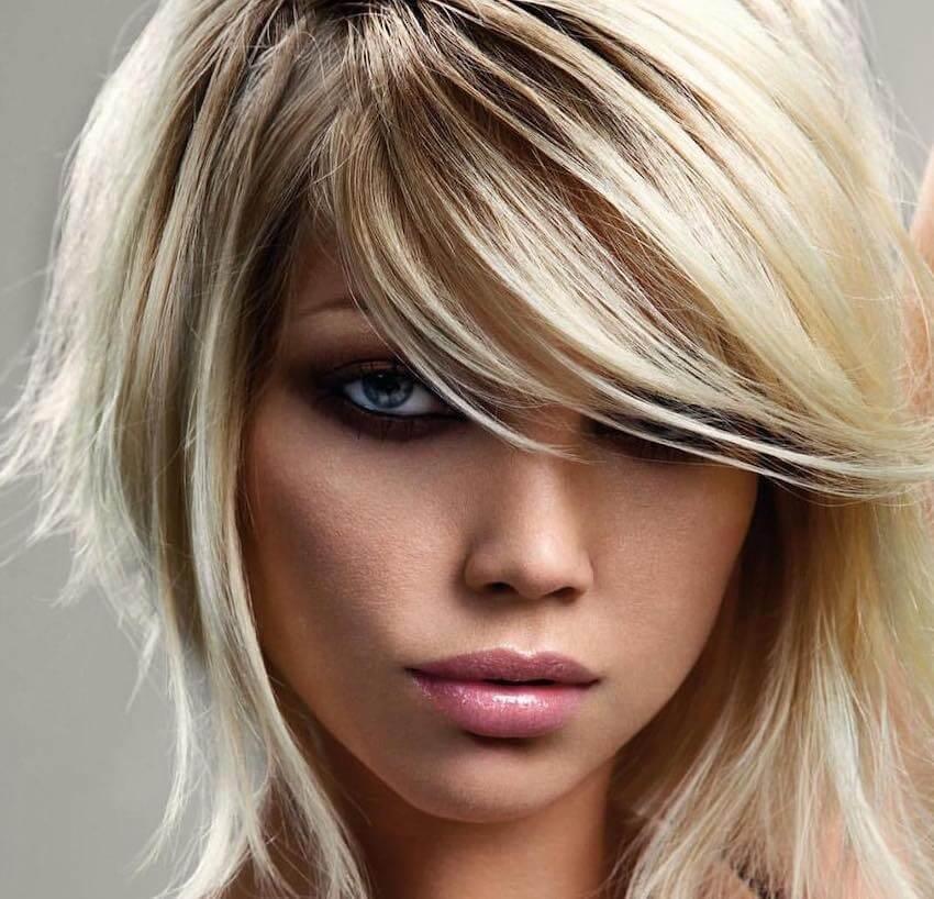 Tagli capelli corti lisci viso rotondo